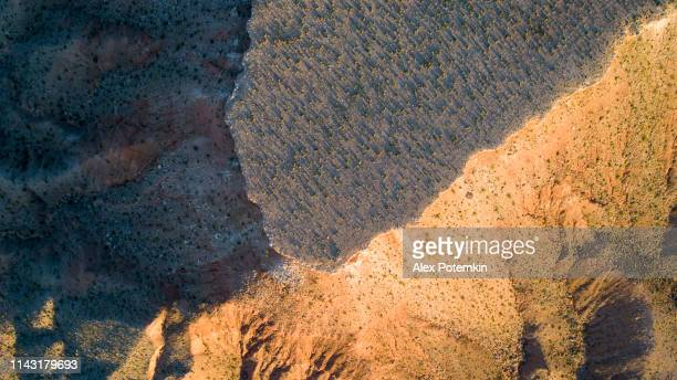 aerial view of table mountains in a highland nearby mesquite, nevada, usa, in the early springtime. top view directly above photo. - nevada stock pictures, royalty-free photos & images
