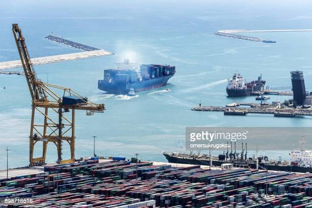 aerial view of tanker ship at port in barcelona - national landmark stock pictures, royalty-free photos & images