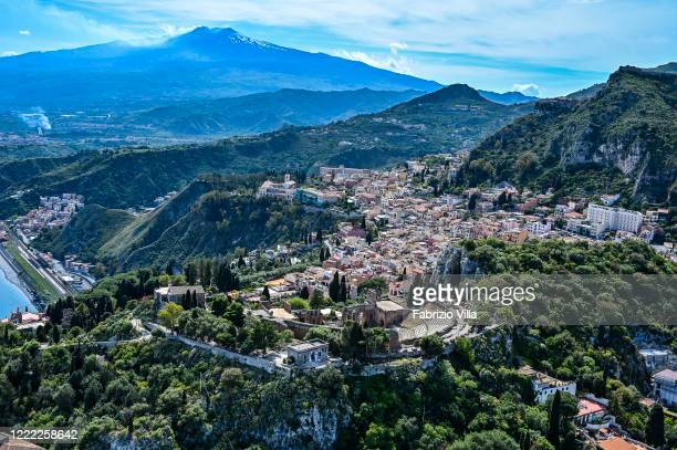 Aerial view of Taormina with the Teatro Antico and the Etna volcano in the backgroundon May 01 2020 in Taormina Italy Italy is still on lockdown to...