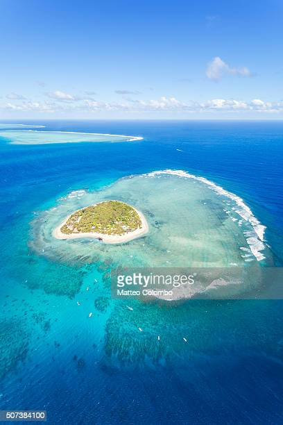 aerial view of tavarua, heart shaped island, fiji - western division fiji stock photos and pictures