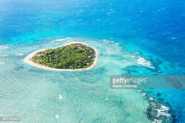 aerial view of tavarua, heart shaped island, mamanucas, fiji - western division fiji stock photos and pictures