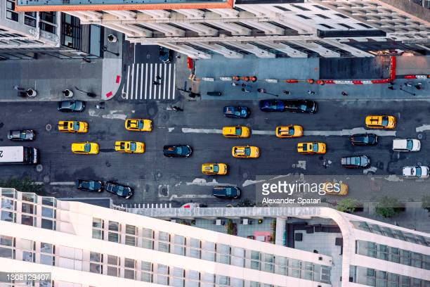 aerial view of taxi cars driving on fifth avenue, new york city, usa - manhattan new york city stock pictures, royalty-free photos & images