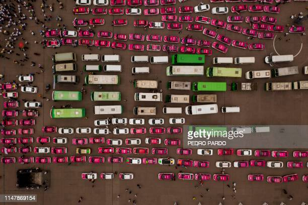 Aerial view of Taxi drivers during a protest against the private taxi company Uber and others Apps for alleged unfair competition at the Zocalo...