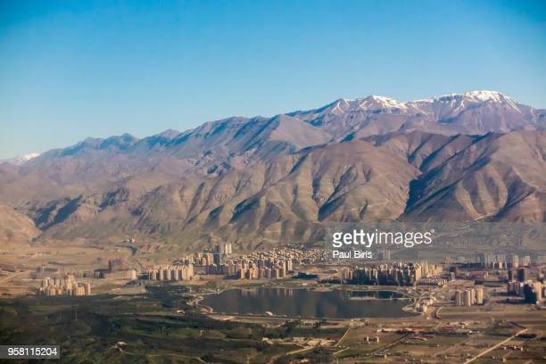 aerial view of tehran facing north towards the alborz mountains, iran - tehran stock pictures, royalty-free photos & images