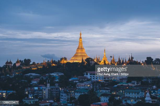 aerial view of temple in city against sky, yangon, myanmar - myanmar stock pictures, royalty-free photos & images