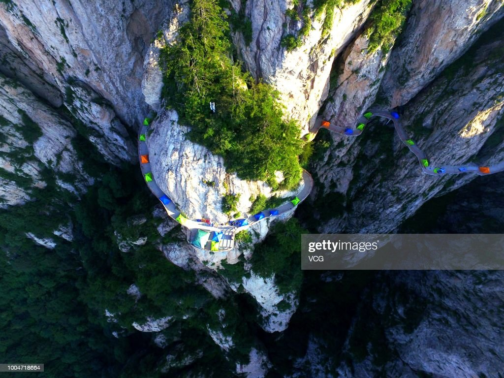 Backpackers Set Up Tents On Cliff Face In Luoyang