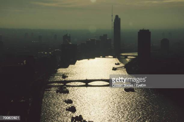 aerial view of thames river amidst city during sunset - bortes stock photos and pictures