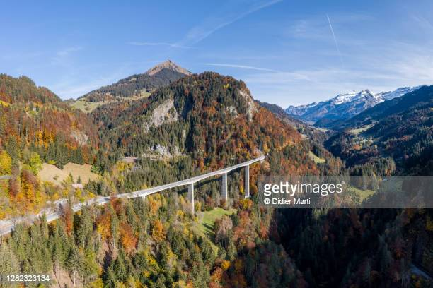 aerial view of the aigremont bridge leading to the diablerets village in canton vaudin switzerland - vaud canton stock pictures, royalty-free photos & images