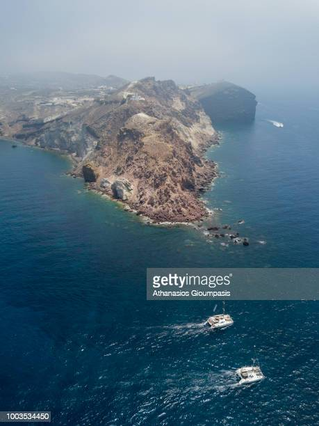 Aerial view of The Akrotiri Lighthouse on July 17, 2018 in Santorini, Greece. The Akrotiri Lighthouse is among the oldest lighthouses in Greece and...