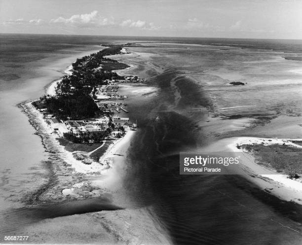 Aerial view of the Alice Town shoreline on North Bimini Island with South Bimini across the harbour at the bottom right Bimini Bahamas 1950s or 1960s...