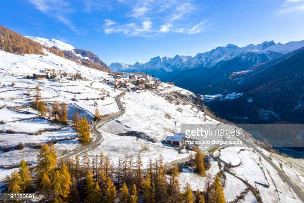 aerial view of the alpine village in late autumn with fresh snow. - switzerland stock pictures, royalty-free photos & images