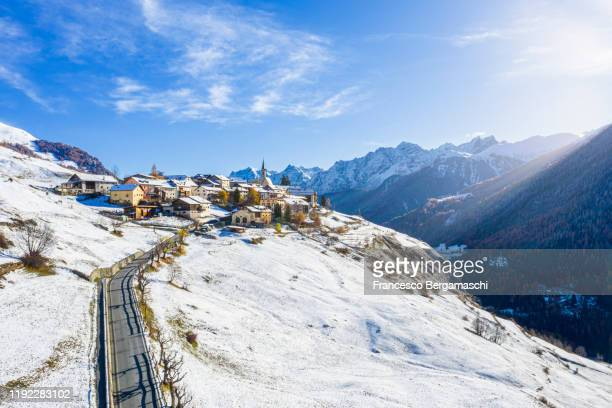 aerial view of the alpine village in winter. - guarda switzerland stock pictures, royalty-free photos & images