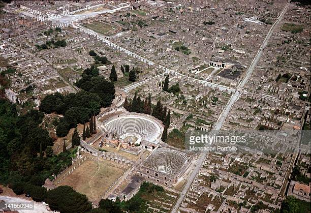 Aerial view of the ancient city with the Grand Theatre the Odeon or Little Theatre and the fourportico Theatre Pompeii 1970s