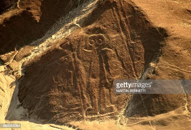 Aerial view of the anthropomorphic geoglyph known as the Astronaut at Nazca Lines some 435 km south of Lima Peru on December 11 2014 Geoglyphs can be...
