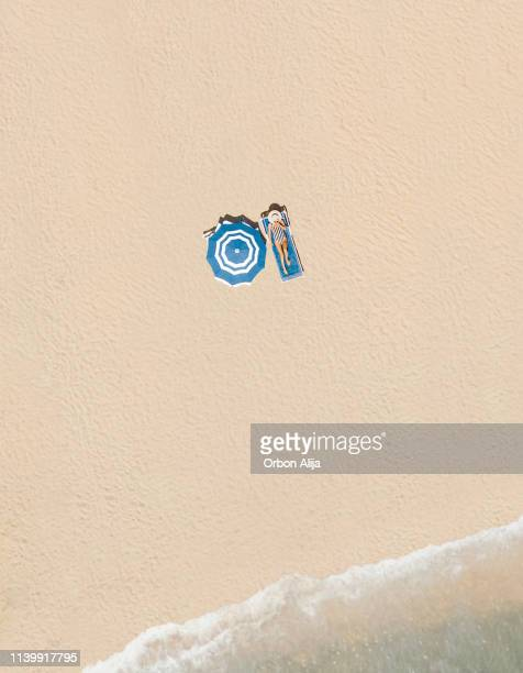 aerial view of the beach - directly above stock pictures, royalty-free photos & images