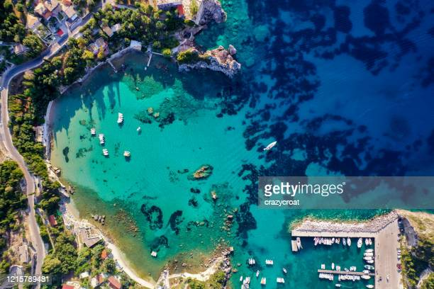 aerial view of the beautiful corfu coastline shot from the air, showing deep blue colours of the mediterranean sea. - corfu stock pictures, royalty-free photos & images