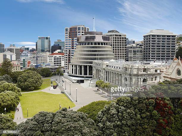 aerial view of the beehive and nz parliament house - wellington new zealand stock photos and pictures