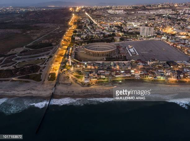 Aerial view of the border fence between Mexico and the US seen from Playas de Tijuana Baja California state Mexico on August 11 2018
