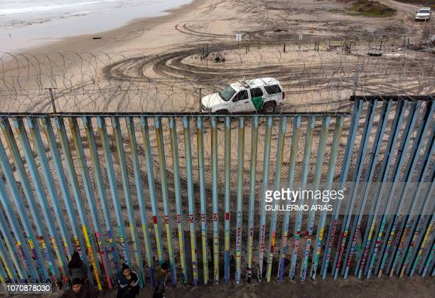 Aerial view of the border patrol guarding the USMexico border fence trying to dissuade Central American migrant caravan members from crossing at...