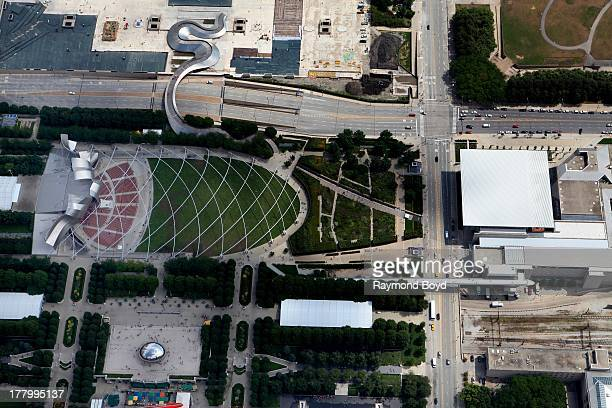 Aerial view of the BP Bridge Jay Pritzker Pavilion and Anish Kapoor's Cloud Gate sculpture in Millennium Park as photographed over downtown Chicago...