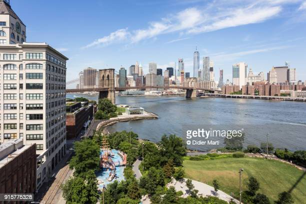 Aerial view of the Brooklyn bridge and its park with Manhattan skyline across the East river in New York city