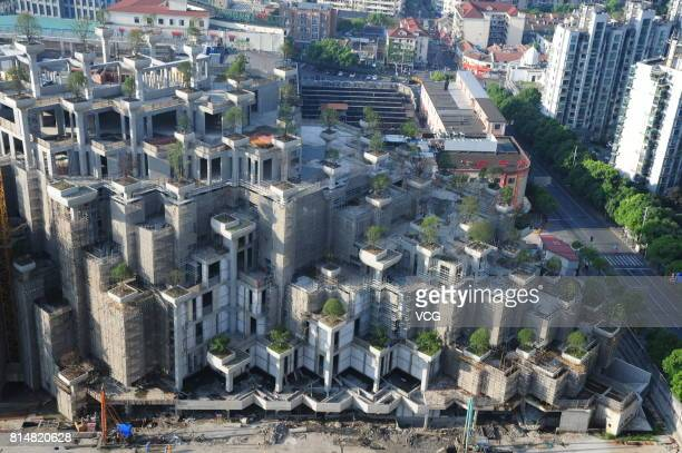 Aerial view of the building dubbed as the Hanging Gardens of Babylon under construction on July 15 2017 in Shanghai China The building will be...