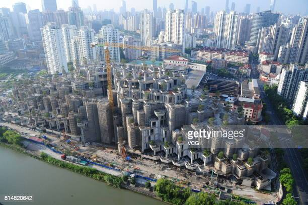 Aerial view of the building dubbed as the Hanging Gardens of Babylon under construction on July 15, 2017 in Shanghai, China. The building will be...