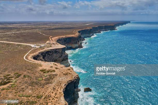 aerial view of the bunda cliffs - nullarbor plains, great australian bight marine park. - coastline stock pictures, royalty-free photos & images