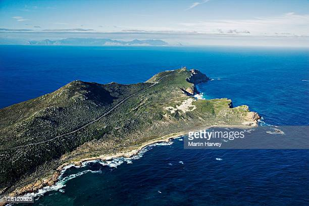 aerial view of the cape point nature reserve. one of the most spectacular parks in south africa, this fynbos covered hill stretch out into the atlantic ocean. cape point is not the southernmost point of africa. western cape province, south africa. - península fotografías e imágenes de stock
