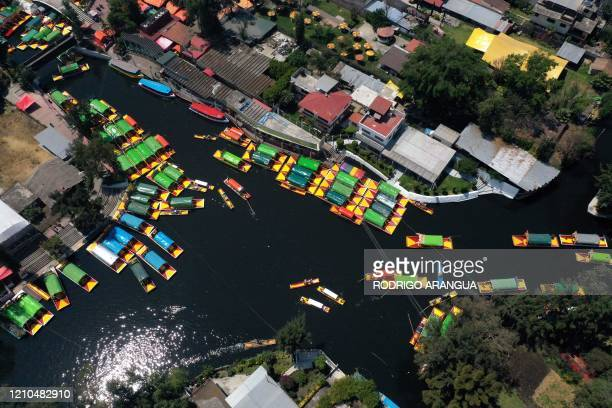Aerial view of the channels of Xochimilco a transportation system created by the Aztecs in Mexico City on March 14 2020 April 22 2020 commemorates...