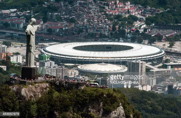 Aerial view of the Christ the Redeemer statue atop Corcovado Hill and the Mario Filho stadium in Rio de Janeiro Brazil on December 3 2013 The...
