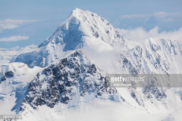 aerial view of the chugach mountains in winter outside anchorage, alaska. - chugach mountains stock pictures, royalty-free photos & images