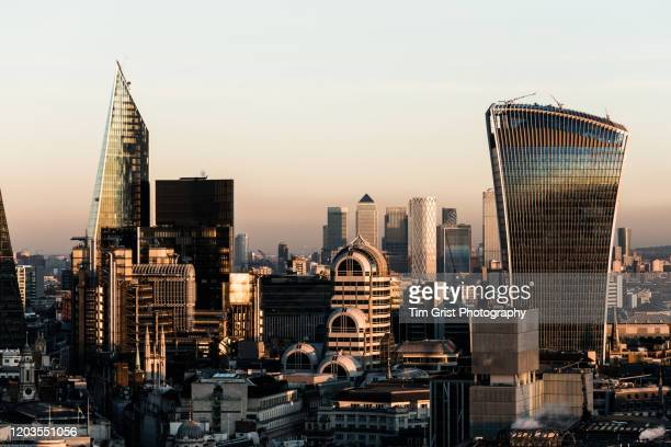 aerial view of the city of london skyline at dusk. london, uk. - tim grist stock pictures, royalty-free photos & images