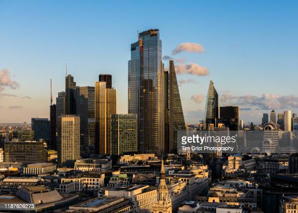 aerial view of the city of london's financial district and canary wharf in the distance. london, uk. - brexit stock pictures, royalty-free photos & images