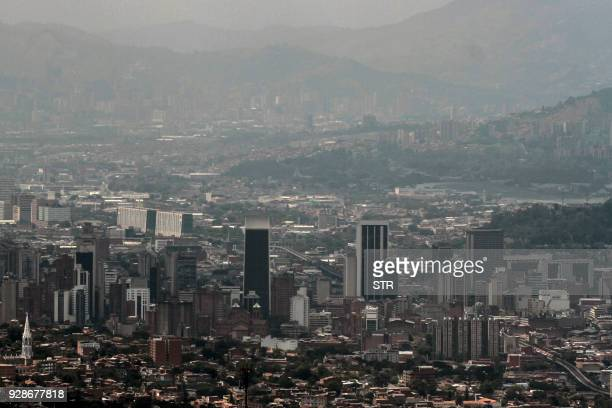 Aerial view of the city of Medellin northwest Colombia covered by heavy smog on March 7 2018 Medellin the second most populated city of Colombia...