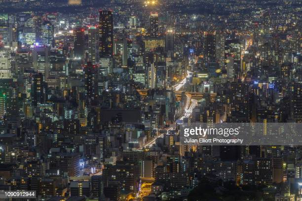 aerial view of the city of osaka in japan. - urban sprawl stock pictures, royalty-free photos & images