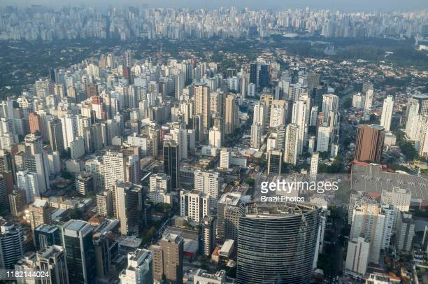 Aerial view of the city of Sao Paulo Brazil dense populated neighborhood Itaim Bibi district Credit Suisse building in foreground mixed with green...