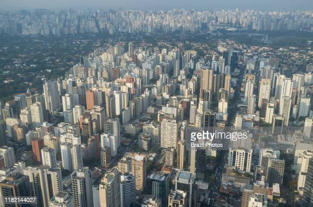 Aerial view of the city of Sao Paulo Brazil dense populated neighborhood Itaim Bibi district in foreground mixed with green upperclass area in...