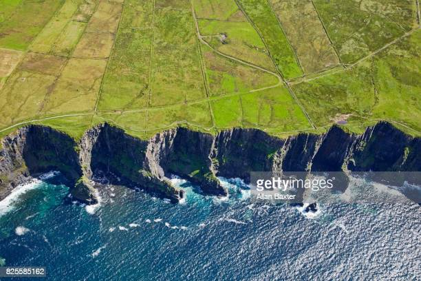 "aerial view of the ""cliffs of moher"" in ireland - beauty in nature stock pictures, royalty-free photos & images"