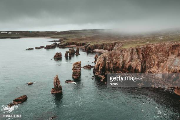 aerial view of the coastline and cliffs of the shetland - coastline stock pictures, royalty-free photos & images