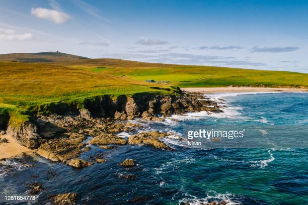 aerial view of the coastline coastline of unst island in shetland islands - aerial view stock pictures, royalty-free photos & images