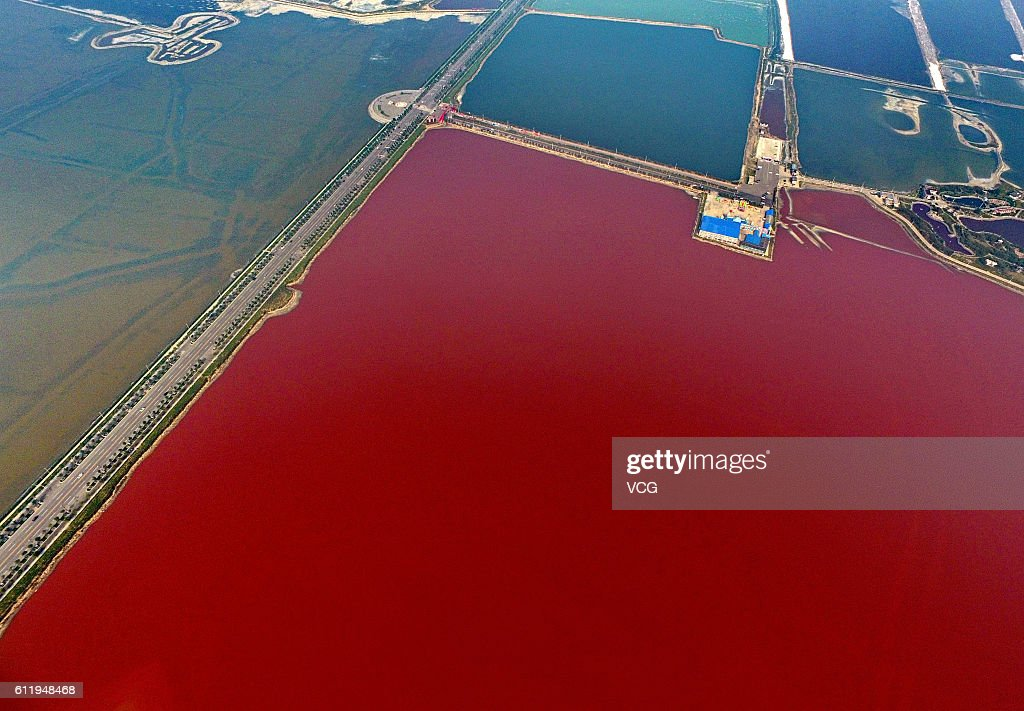 Aerial view of the colorful salt lake on October 2, 2016 in Yuncheng, Shanxi Province of China. The salt lake displaying red and green colors in Yuncheng attract tourists during the National Day holiday. Formed about 500 million years ago, the salt lake owns different colors as a result of the algae in the water.
