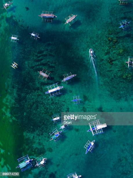 Aerial View of the colorful typical wooden boats in the Philippines