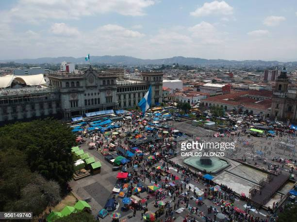 Aerial view of the Constitution square and the National Palace in Guatemala City on May 08 2018 where Guatemalan teachers are camping as part of a...