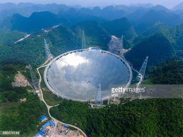 Aerial view of the construction site of a Fivehundredmeter Aperture Spherical Telescope on May 7 2016 in Pingtang County Guizhou Province of China...