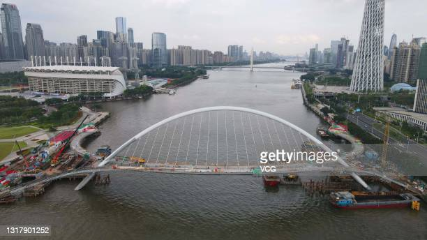 Aerial view of the construction site of a pedestrian bridge, connecting the east bank of Ersha Island and the Canton Tower, over the Pearl River on...
