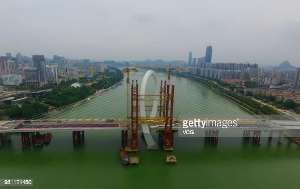 Aerial view of the construction site of Baisha Bridge on June 21 2018 in Liuzhou Guangxi Zhuang Autonomous Region of China Baisha Bridge the world's...