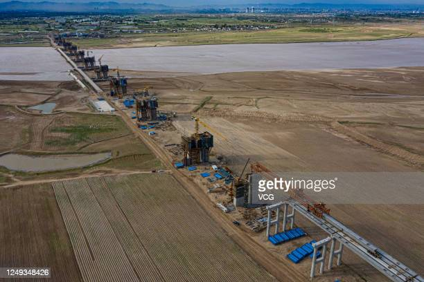 Aerial view of the construction site of Zhaojun Yellow River Bridge on June 12, 2020 in Baotou, Inner Mongolia Autonomous Region of China.