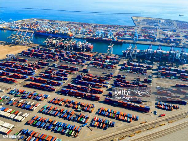 aerial view of the container port at san pedro in los angeles, with ships docked and containers awaiting loading. a commercial freight dockyard. - la waterfront stock pictures, royalty-free photos & images