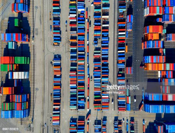 aerial view of the container port at san pedro in los angeles, with containers awaiting loading. a commercial freight dockyard. - la waterfront stock pictures, royalty-free photos & images